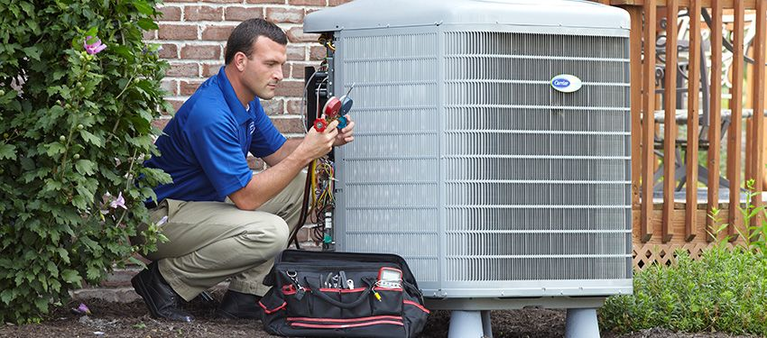 man repairing carrier air conditioner