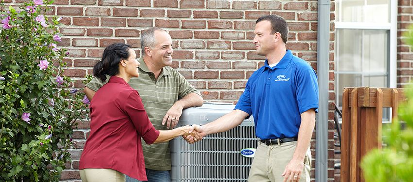 homeowners having air conditioner maintenance done