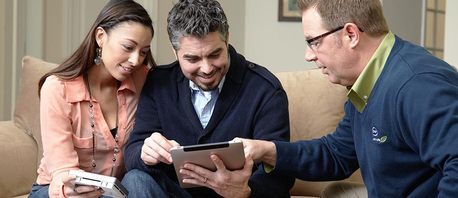 Family discussing HVAC options with a technician