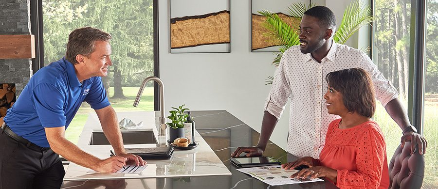 HVAC salesperson discussing products with homeowners